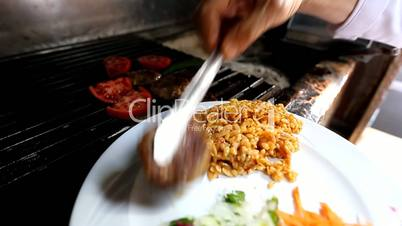 Turkish grilled meatball to the plate