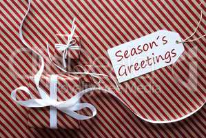 Two Gifts With Label, Text Seasons Greetings