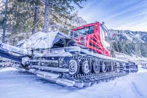 Snow groomer car, on the side view