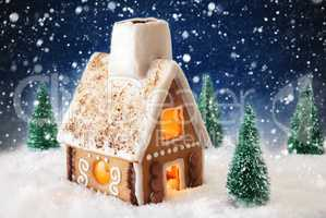 Gingerbread House On Snow With Snowflakes And Blue Background