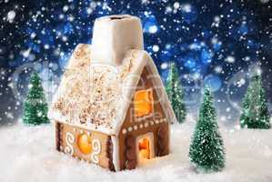 Gingerbread House On Snow, Snowflakes And Bokeh Effect