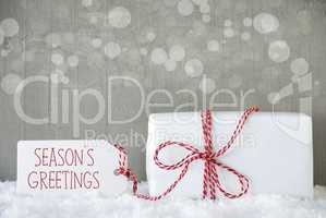 Gift, Cement Background With Bokeh, Text Seasons Greetings