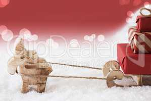 Reindeer With Sled, Red Bokeh Background, Copy Space