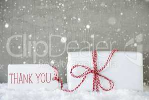 Gift, Cement Background With Snowflakes, Text Thank You