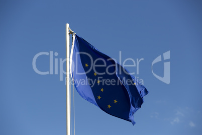 National flag of Alaska on a flagpole