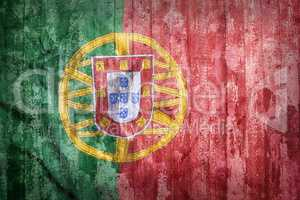 Grunge style of Portugal flag on a brick wall