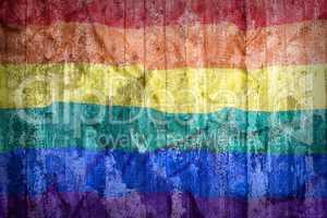 Rainbow flag on a brick wall