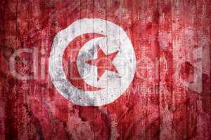 Grunge style of Tunisia flag on a brick wall