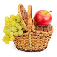 grapes and apple in the basket isolated on a white background
