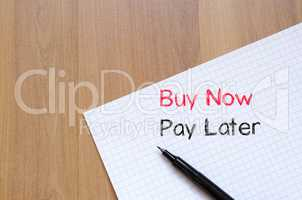 Buy now pay later text concept on notebook