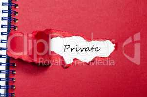 The word private appearing behind torn paper