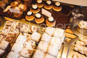 Various sweet foods in bakery shop