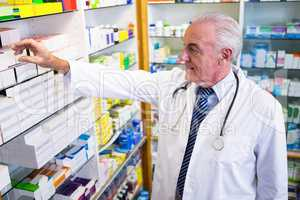 Pharmacist checking medicines in pharmacy
