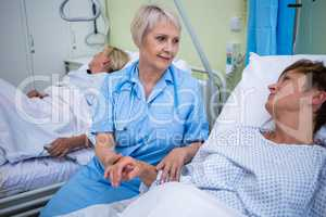 Nurse examining patients pulse
