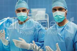 Portrait of male surgeons preparing for operation in operation r