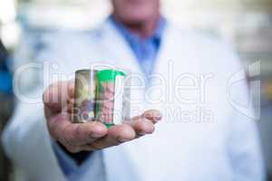 Pharmacist holding a bottle of drug