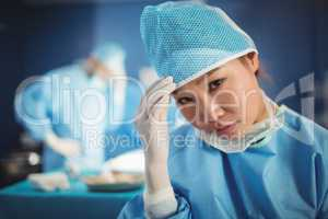 Portrait of female surgeon in operation room