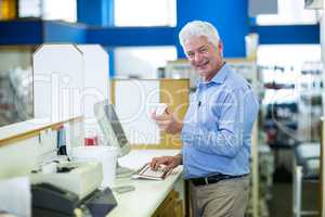 Pharmacist making prescription record through computer in pharma