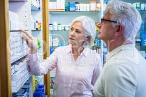Customers checking medicines