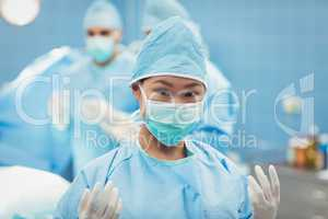 Portrait of female surgeon preparing for operation in operation
