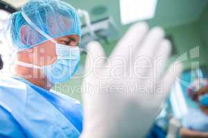 Surgeon preparing for operation in operation room