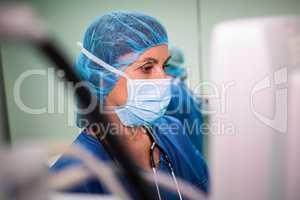 Surgeon using monitor