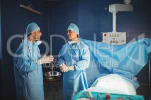 Surgeons interacting with each other in the operation room