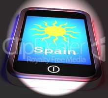 Spain On Phone Displays Holidays And Sunny Weather