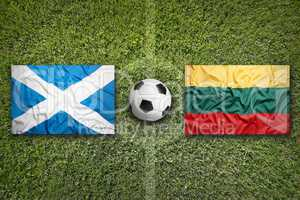 Scotland and Lithuania flags on soccer field