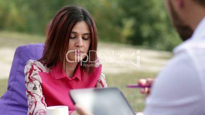 Businesswoman presenting business plan to partner