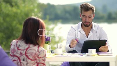Businessman discussing with partner growth of sale