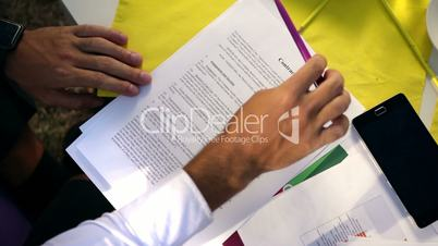 Businessman doubting about signing a contract