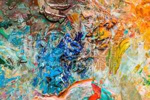 Blackboard artist with oil paints