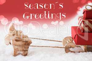 Reindeer With Sled, Red Background, Text Seasons Greetings
