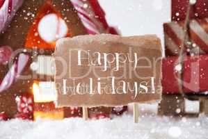 Gingerbread House With Sled, Snowflakes, Text Happy Holidays