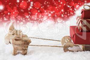 Reindeer With Sled, Copy Space, Red Stars And Bokeh Background