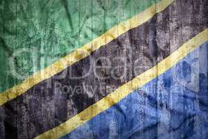 Grunge style of Tanzania flag on a brick wall