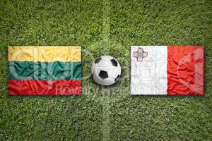 Lithuania vs. Malta flags on soccer field