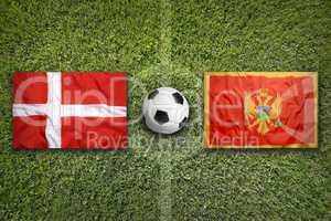 Denmark vs. Montenegro flags on soccer field