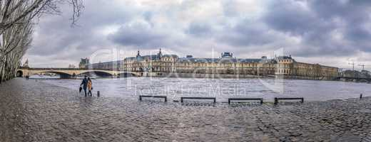 The Seine River and its shore on a rainy day