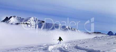 Panoramic view on snowboarder downhill on off-piste slope with n