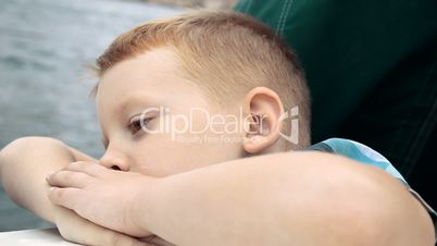 The Boy Looks At The Sea And Falls Asleep