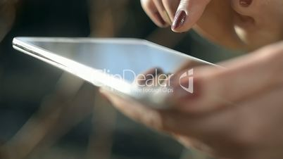 Adult Woman Using Tablet PC In Sunny Day Outdoor