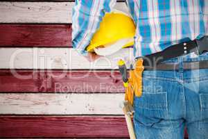 Composite image of rear view of handyman wearing tool belt