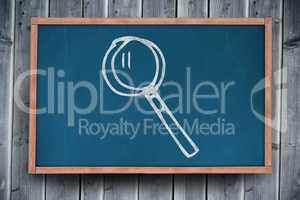 Composite image of magnifying glass over white background