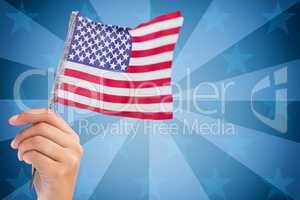American flag against sunburst