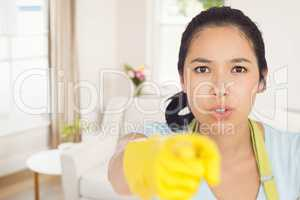 Composite image of accusing woman in apron pointing