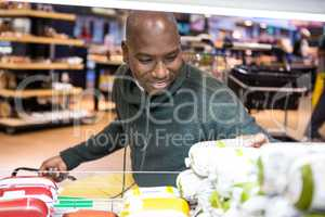 Man looking at goods in grocery section while shopping