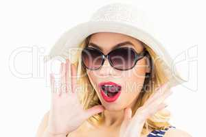 Beautiful woman posing with shocked expression against white background