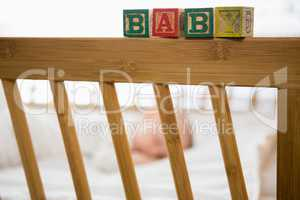 Alphabet blocks on baby bed
